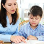 Mom and Son reading Bible